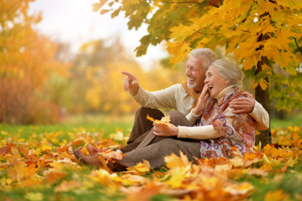 Older couple enjoying fall pain while preventing back pain