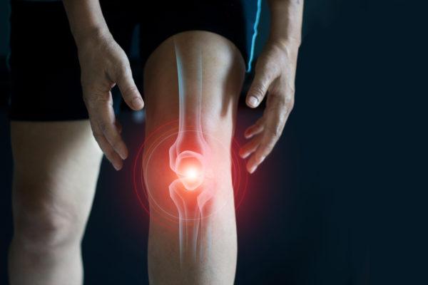 elderly person suffering osteoarthritis pain in knee