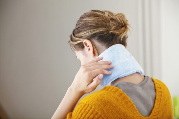 heat or cold therapy pack on woman's neck